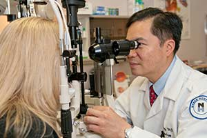 Dr. John Chang conducting a cataract exam at Spinak Medical Eye Center